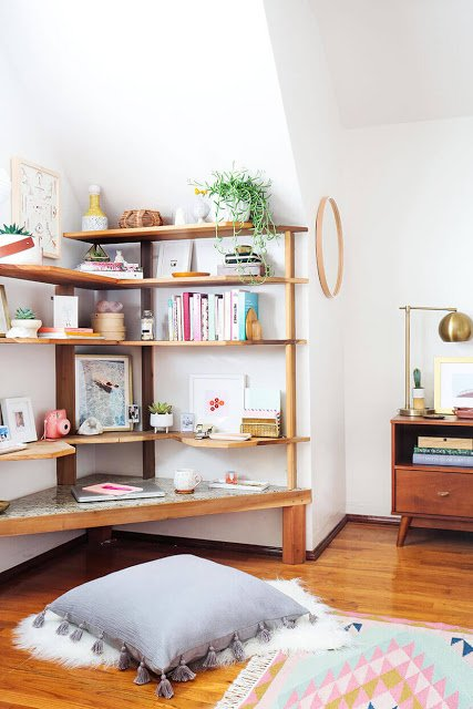 corner shelves and corner desk create a home office in small spaces