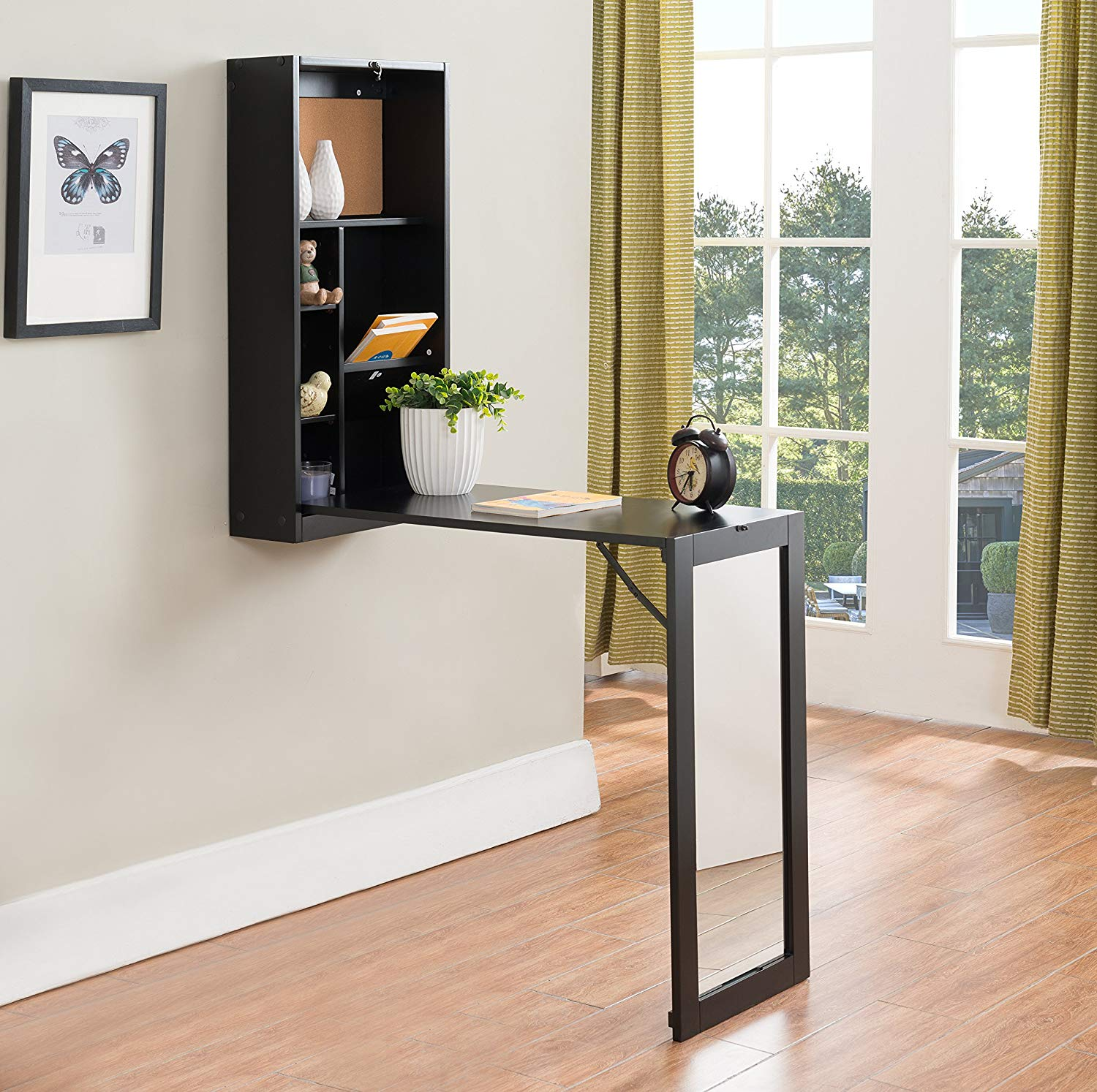 fold up desk used for creating a home office in a small space