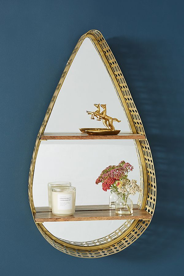 Gold teardrop mirror with wooden shelves