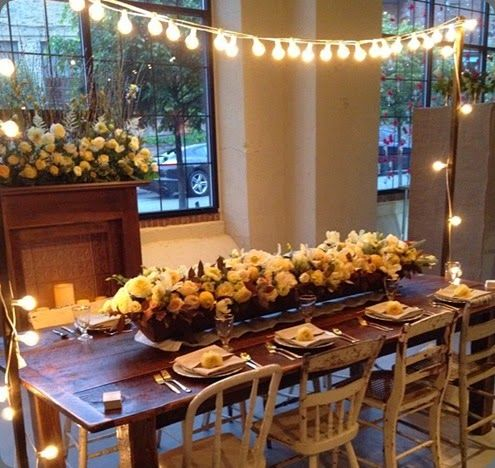 Dinner table decor using overhead String lights
