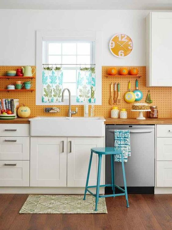 orange kitchen pegboard back splash