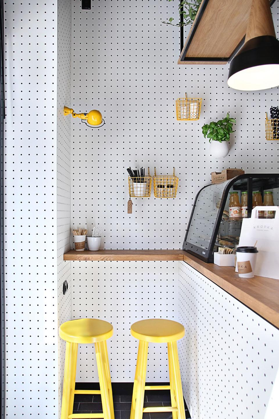 Kitchen covered in pegboards