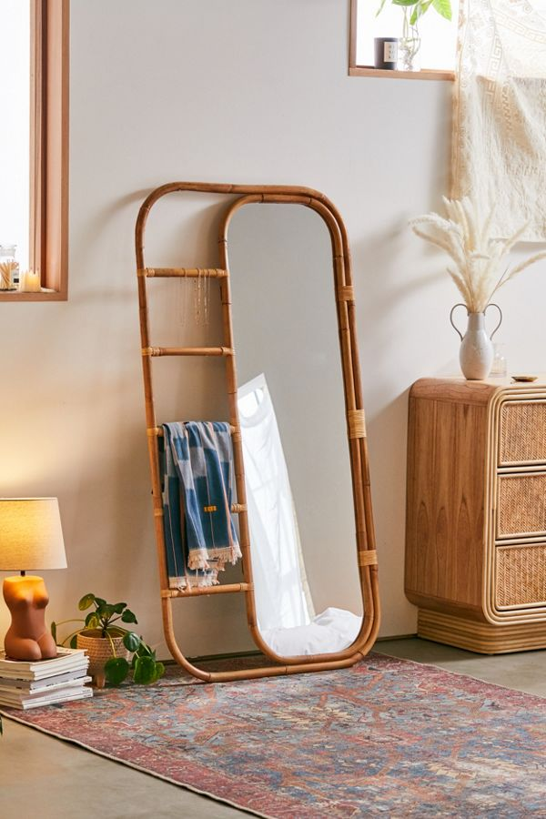 Leaning Rattan Mirror with storage racks urban outfitters