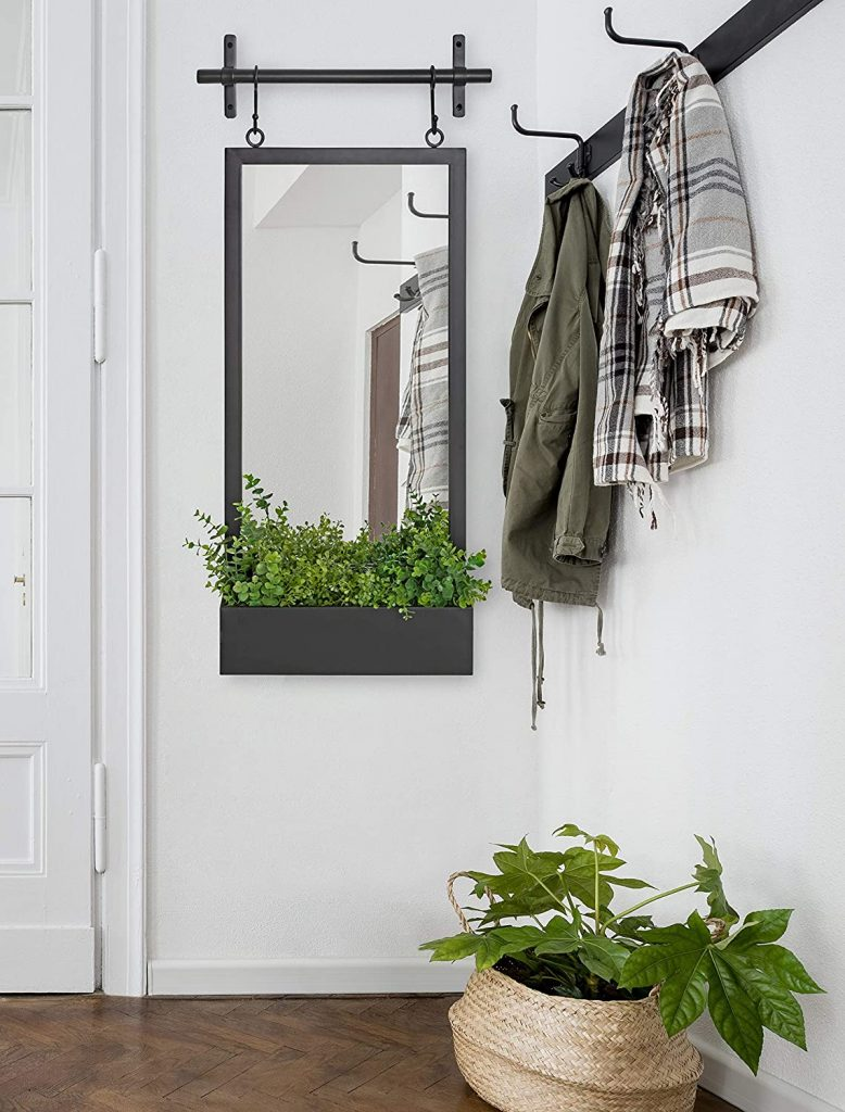 black metal framed wall mirror with shelf storage
