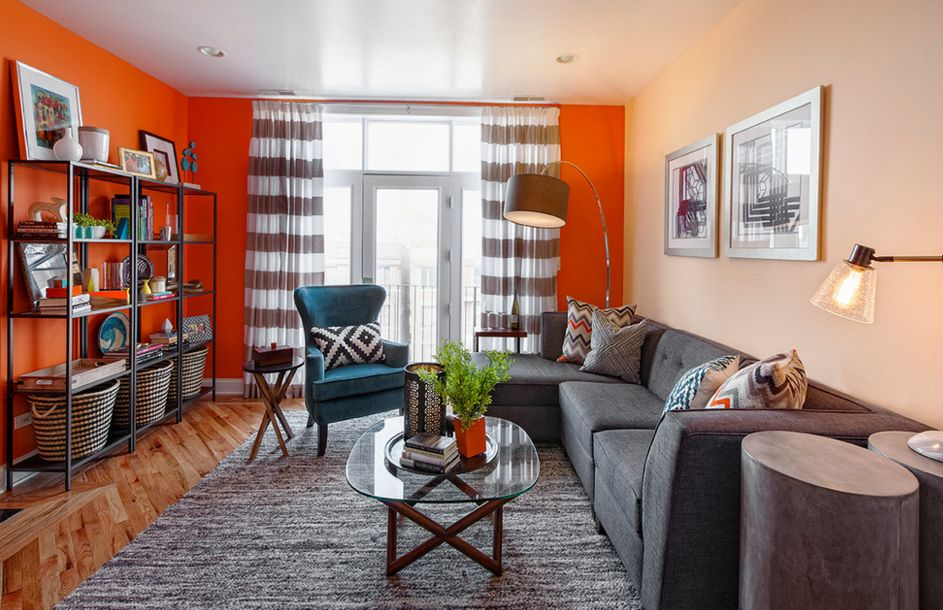 bold orange accent walls in small living room