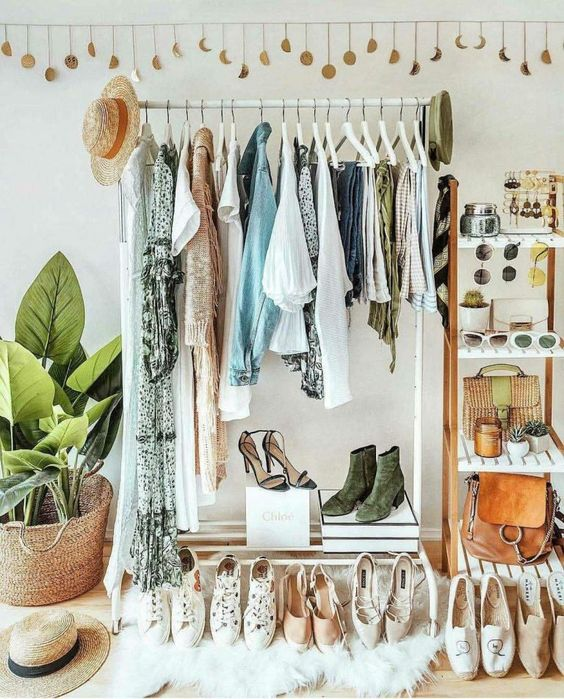stylish clothing rack and wooden shelf for a makeshift closet