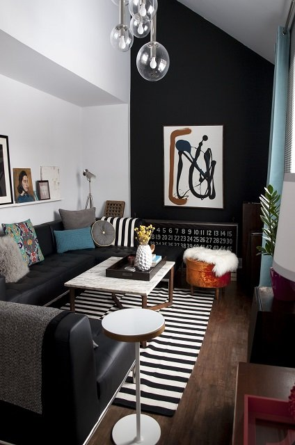 black accent wall in small living room