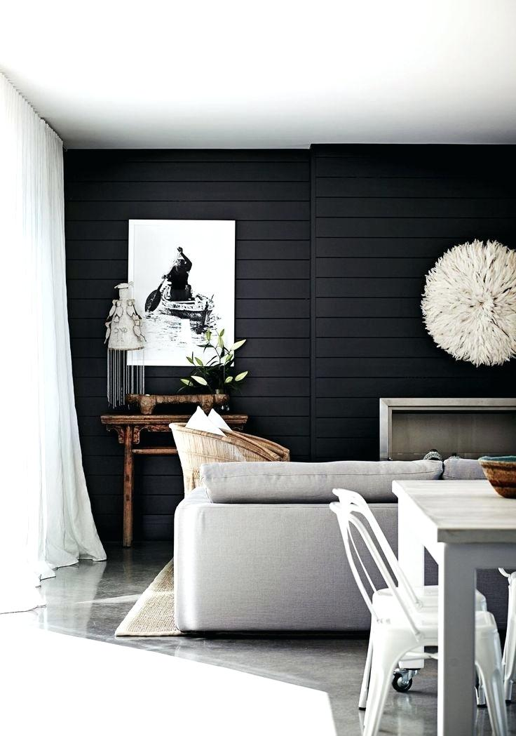 black textured accent wall in small living room