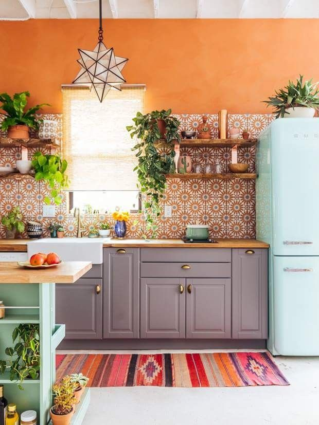 bold small boho kitchen with orange walls