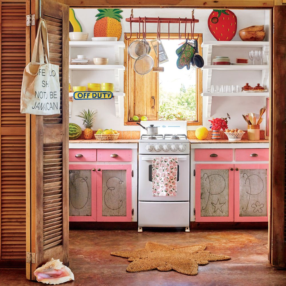 colorful tropical small kitchen with pink cabinets