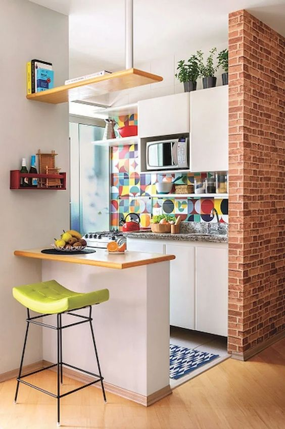 bold colorful backslash tile in small kitchen