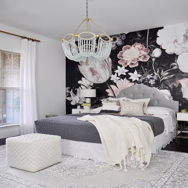 large pink and black floral wallpaper in a small bedroom