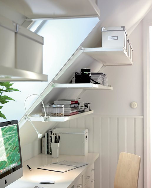 small corner office nook with shelves