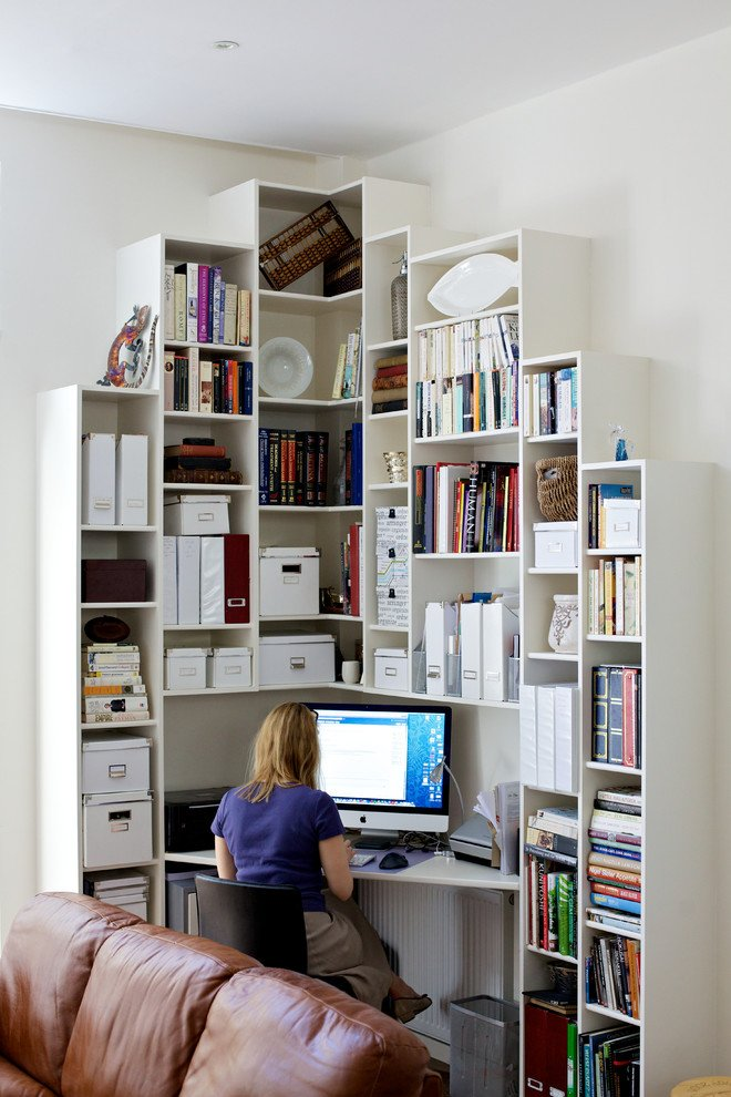 small office nook with tall bookshelves