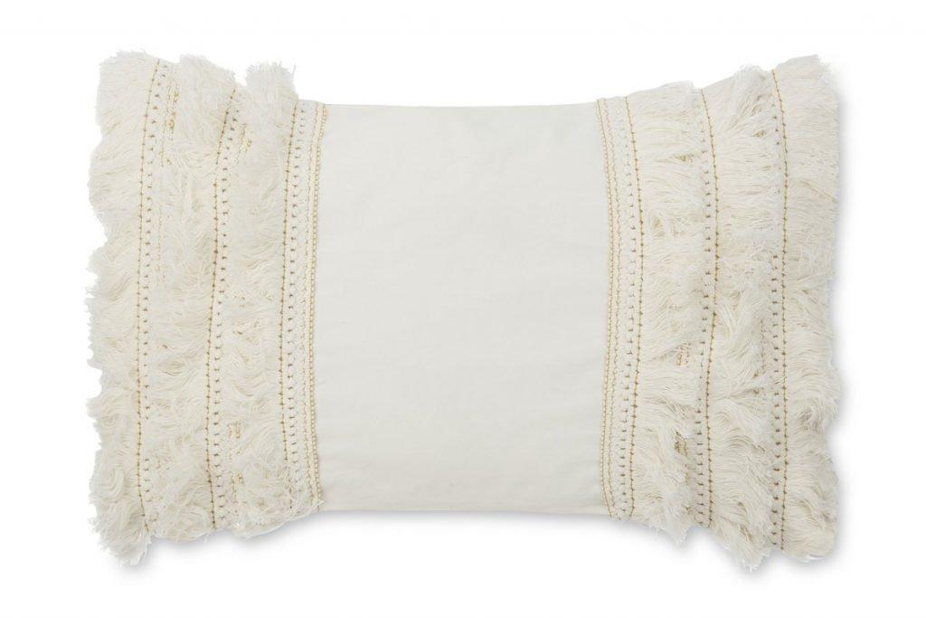 cream fringe accent pillow