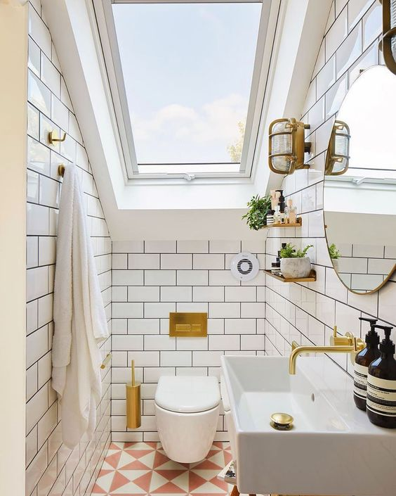 bright white and gold small bathroom