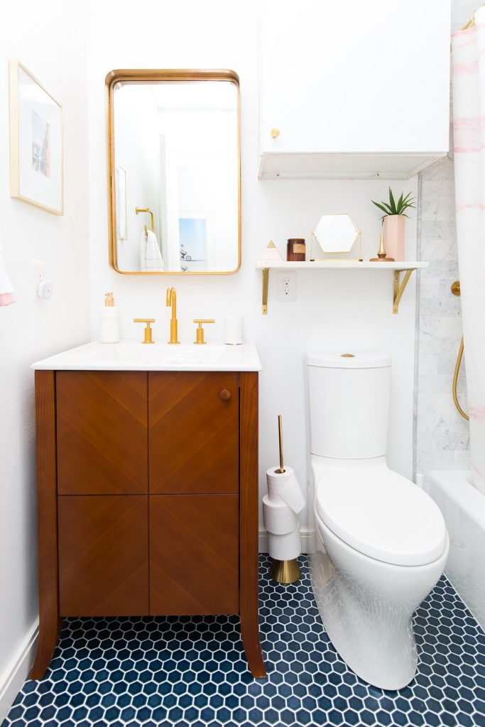 bright white and gold small bathroom decor