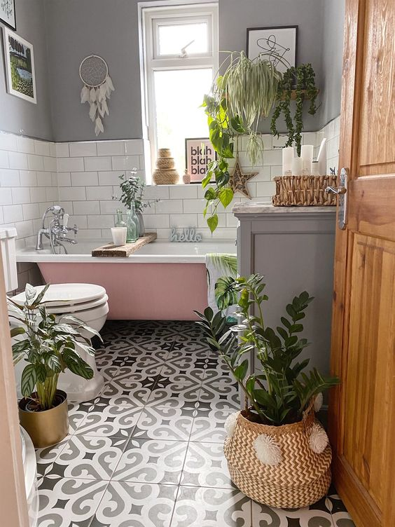gray and white bathroom with plants