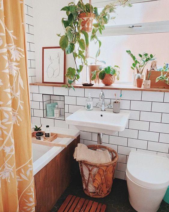 warm plant filled small bathroom decor
