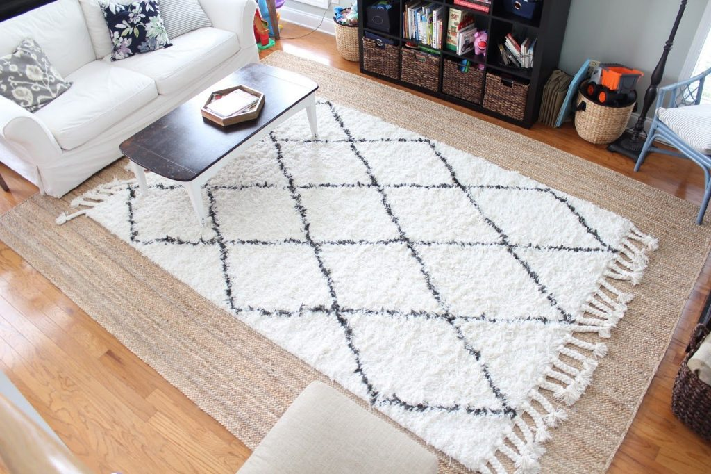 layered neutral rugs in studio apartment