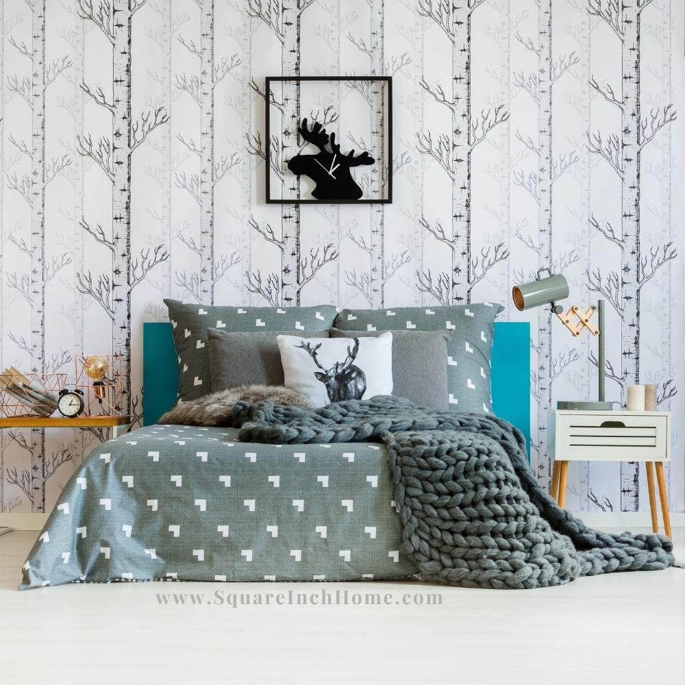 tree trunk stripe wallpaper in small bedroom
