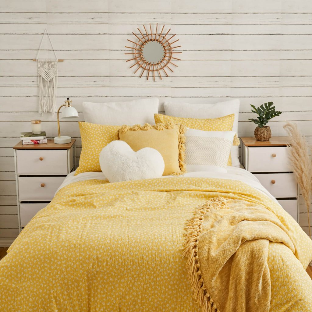 sunny yellow and white dorm room